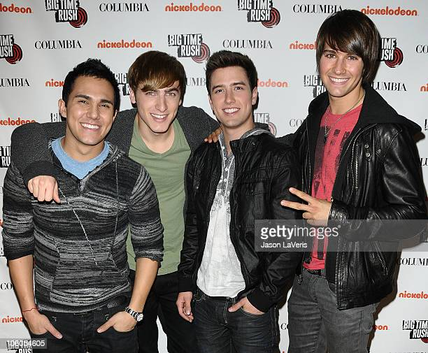 Carlos Pena Jr Kendall Schmidt Logan Henderson and James Maslow of Big Time Rush sign autographs at Universal CityWalk on October 25 2010 in...