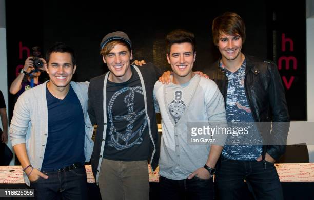 Carlos Pena Jr Kendall Schmidt Logan Henderson and James Maslow of Big Time Rush attend a poster signing at HMV Oxford Street on July 11 2011 in...