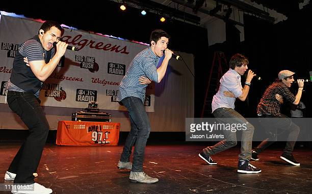 Carlos Pena Jr Logan Henderson James Maslow and Kendall Schmidt of Big Time Rush perform at Torrance High School on March 29 2011 in Torrance...