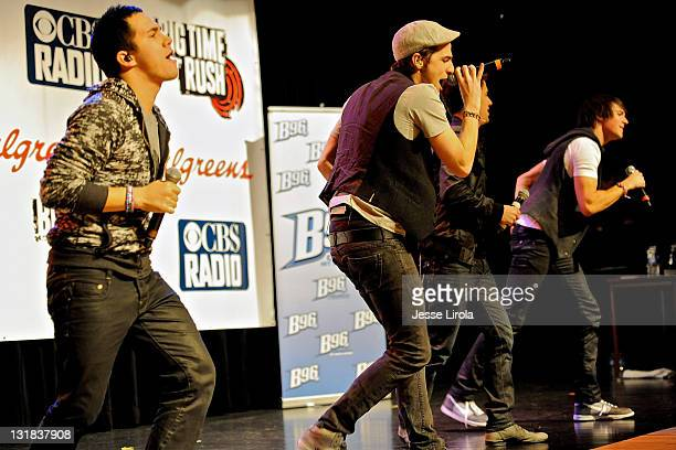 Carlos Pena Kendall Schmidt Logan Henderson and James Maslow of Big Time Rush perform at Sycamore High School on October 29 2010 in Sycamore Illinois