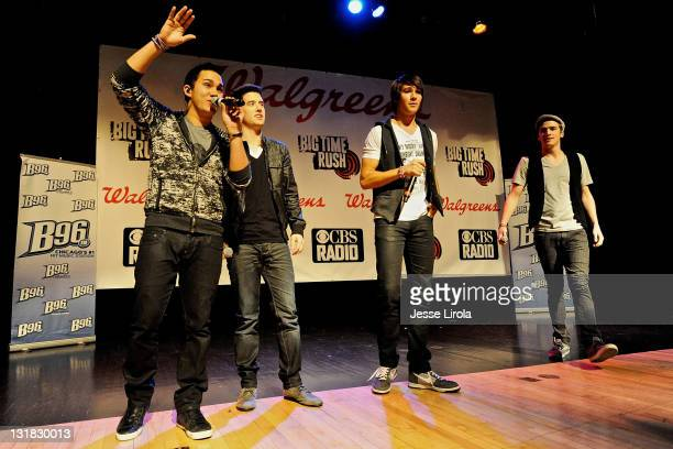 Carlos Pena Logan Henderson James Maslow and Kendall Schmidt of Big Time Rush perform at Sycamore High School on October 29 2010 in Sycamore Illinois