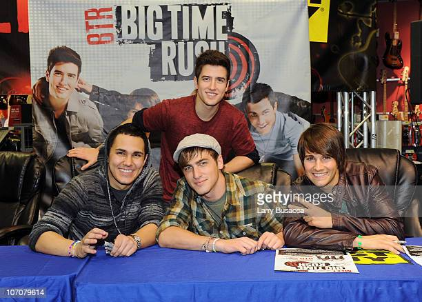 Carlos Pena Logan Henderson Kendall Schmidt and James Maslow of Big Time Rush sign autographs at Nickelodeon's Big Time Rush Best Buy Store...