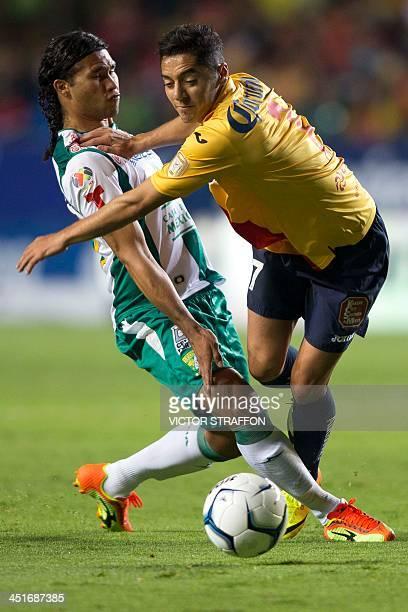 Carlos Pena of Leon vies for the ball with Jose Maria Cardenas Morelia during the quarterfinals of the Apertura 2013 tournament on November 23 2013...