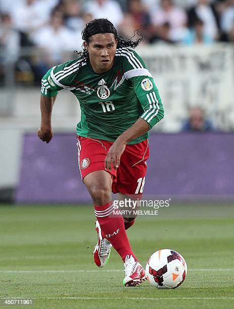 Carlos Pena of Mexico dribbles the ball against New Zealand in their World Cup qualifying football match in Wellington on November 20 2013 Mexico won...