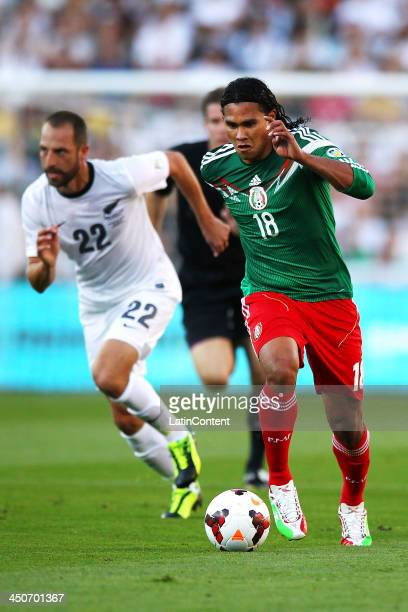 Carlos Pena of Mexico gets past Andrew Durante of New Zealand during leg 2 of the FIFA World Cup Qualifier match between the New Zealand All Whites...