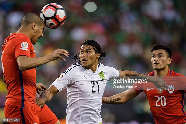 Carlos Pena of Mexico struggle for the ball against Francisco Silva and Charles Aranguiz of Chile during the 2016 Copa America Centenario Group D...