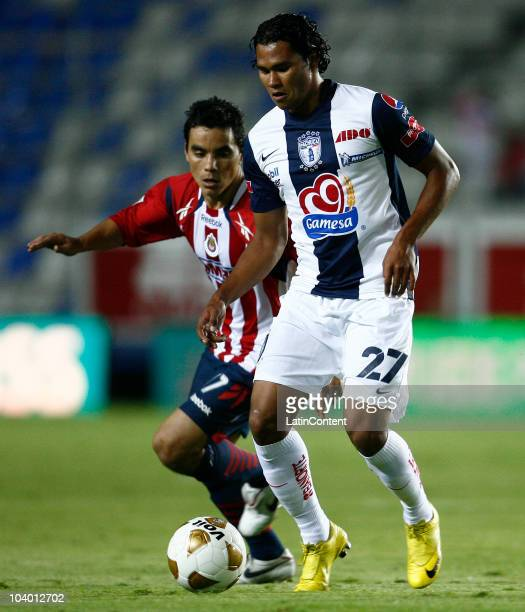 Carlos Pena of Pachuca struggles for the ball with Omar Bravo of Chivas during a match as part of the Apertura 2010 at Hidalgo Stadium on September...