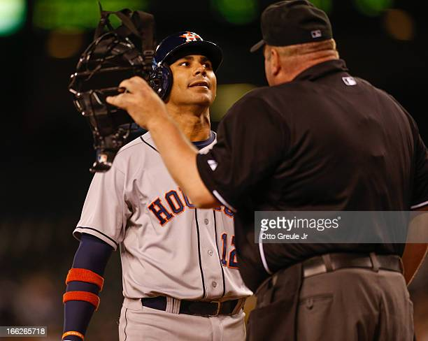 Carlos Pena of the Houston Astros argues a called third strike with home plate umpire Wally Bell in the fifth inning against the Seattle Mariners at...