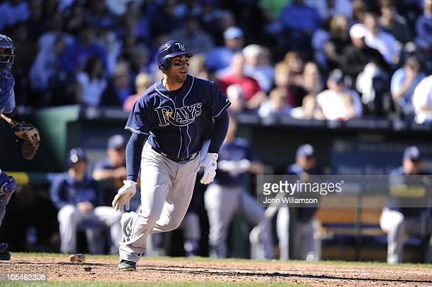 Carlos Pena of the Tampa Bay Rays bats and runs to first from the batter's box in the game against the Kansas City Royals at Kauffman Stadium on...