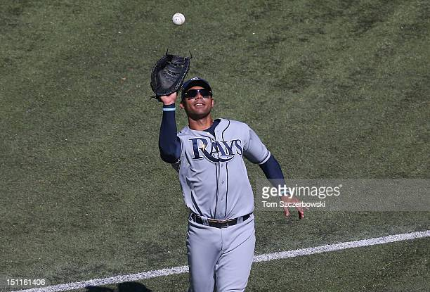 Carlos Pena of the Tampa Bay Rays catches an infield pop up in the sixth inning during MLB game action against the Toronto Blue Jays on September 2...