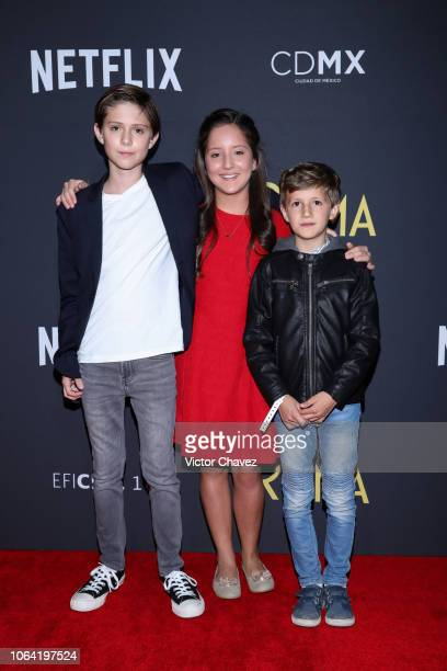 Carlos Peralta Daniela Demesa and Marco Graf pose during the red carpet and screening of Alfonso Cuarón and Netflix film 'Roma' at Cineteca National...