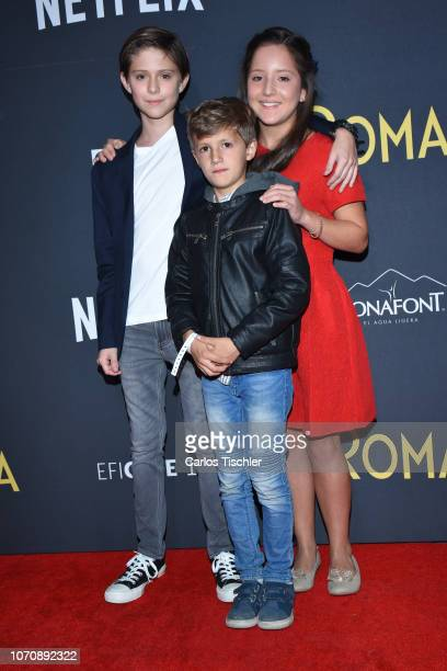 Carlos Peralta Marco Graf and Daniela Demesa poses for photos during the red carpet and screening of the Alfonso Cuaron and Netflix film 'Roma' at...