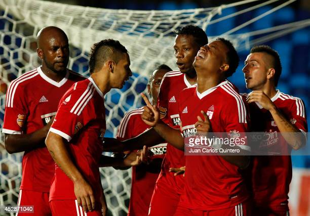 Carlos Peralta of America de Cali celebrates with teammates after scoring his team's second goal during a match between America de Cali and Cucuta as...