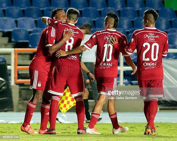 Carlos Peralta of America de Cali celebrates with teammates after scoring his team's third goal during a match between America de Cali and Jaguares...