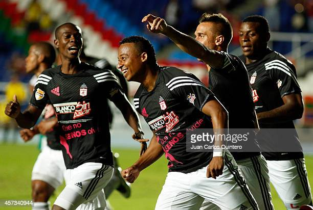 Carlos Peralta of America de Cali celebrates with teammates after scoring the opening goal during a match between America de Cali and Valledupar as...