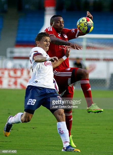 Carlos Peralta of America de Cali fights for the ball with Jonathan Perez of Union Magdalena during a match between America de Cali and Union...