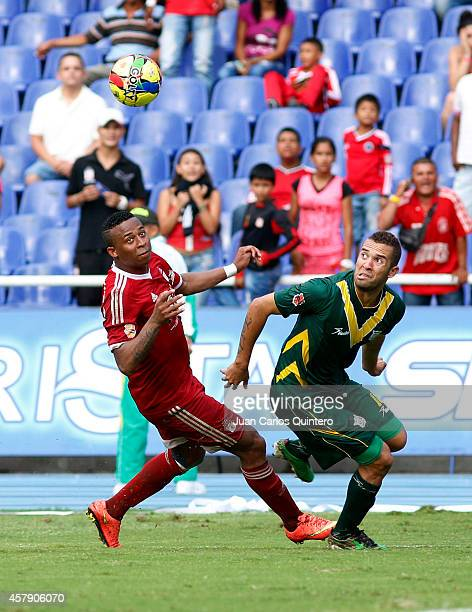 Carlos Peralta of America de Cali struggles for the ball with Heider Riquett of Quindio during a match between América de Cali and Quindio as part of...