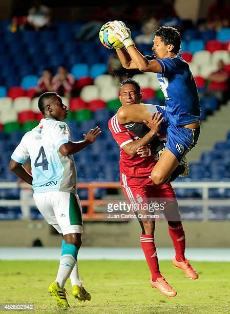 Carlos Peralta of America de Cali struggles for the ball with Ramiro Sanchez of Jaguares during a match between America de Cali and Jaguares as part...