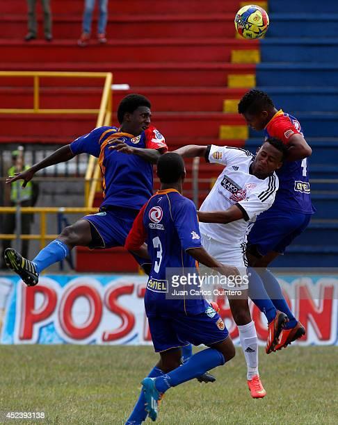 Carlos Peralta of America de Cali struggles for the ball with Jhonatan Rivas of U Popayan during a match between U Popayán and America de Cali as...
