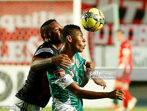 Carlos Peralta of America de Cali struggles for the ball with Saramyz Rodríguez of Valledupar during a match between America de Cali and Valledupar...