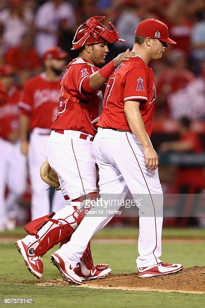 Carlos Perez congratulates Andrew Bailey of the Los Angeles Angels of Anaheim after defeating the Toronto Blue Jays 61 in a game at Angel Stadium of...