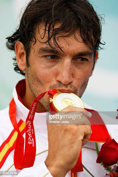 Carlos Perez of Spain celebrates with his gold medal after competing with team mate Saul Craviotto in the Kayak Double 500m Men Final during the...