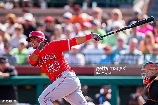 Carlos Perez of the Los Angeles Angels of Anaheim bats during a spring training against the San Francisco Giants at Scottsdale Stadium on March 2...