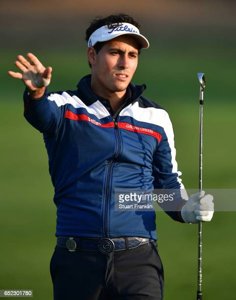 Carlos Pigem of Spain reacts to a shot during the continuation of the delayed third round the Hero Indian Open at Dlf Golf and Country Club on March...