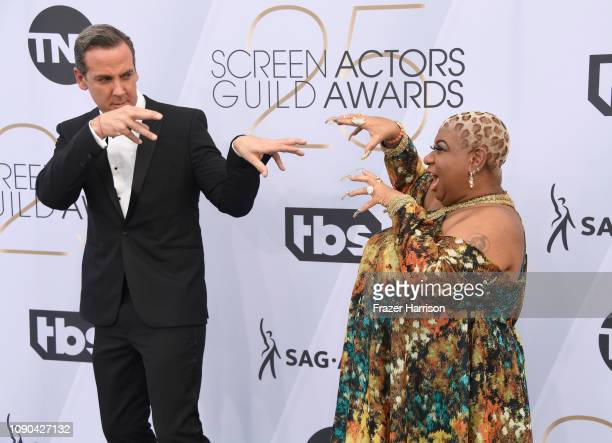 Carlos Ponce and Luenell attend the 25th Annual Screen ActorsGuild Awards at The Shrine Auditorium on January 27 2019 in Los Angeles California