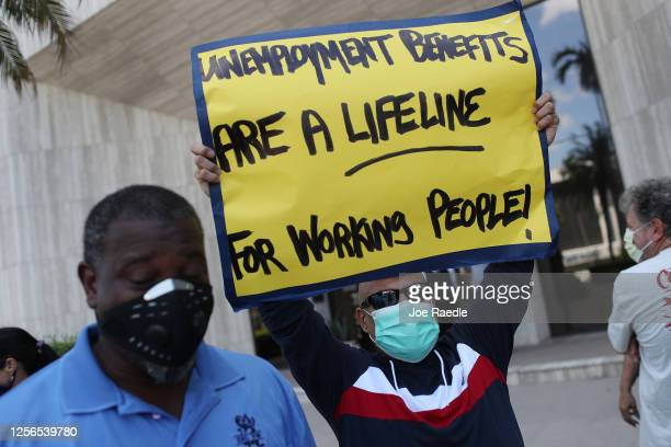 Carlos Ponce joins other demonstrators participating in a protest asking Senators to support the continuation of unemployment benefits on July 16,...