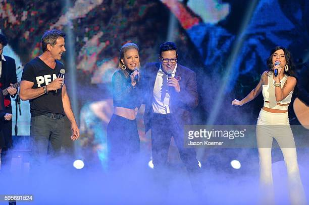 "Carlos Ponce, Laura Flores, Raul Gonzalez and Carolina Gaitan onstage at Telemundo's Premios Tu Mundo ""Your World"" Awards>> at American Airlines..."