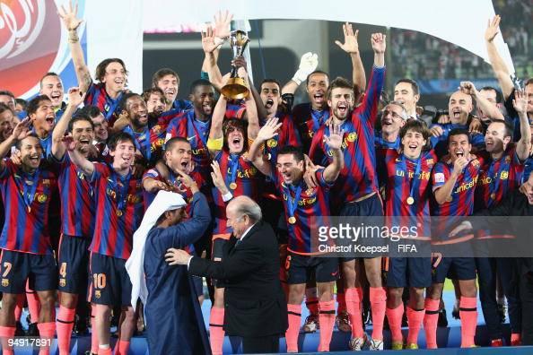 Carlos Puyol holds the cup aloft amongst FC Barcelona ...