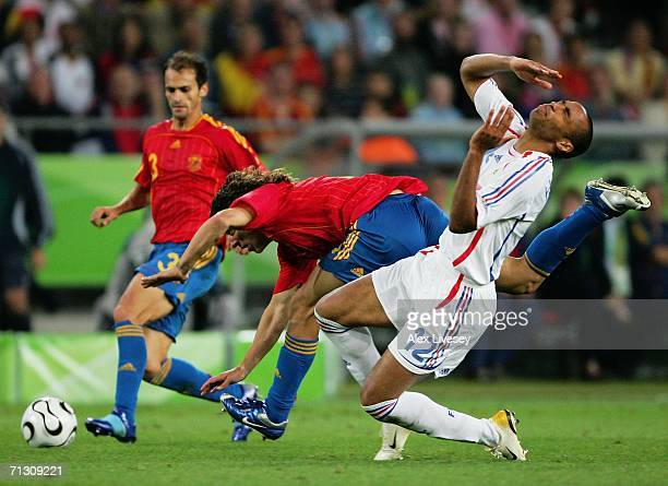 Carlos Puyol of Spain tangles with Thierry Henry of France during the FIFA World Cup Germany 2006 Round of 16 match between Spain and France played...