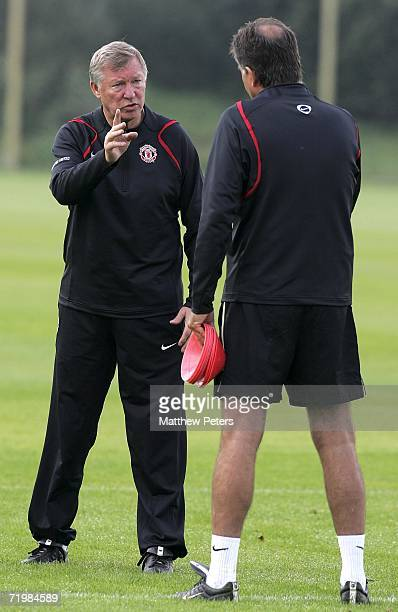 Carlos Queiroz and Sir Alex Ferguson of Manchester United in action during a first team training session at Carrington Training Ground on September...