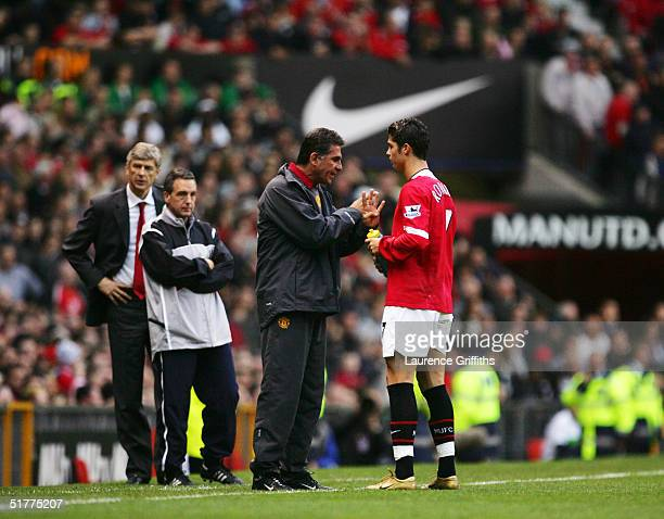 Carlos Queiroz gives Cristino Ronaldo advise during the FA Barclays Premiership match between Manchester United and Arsenal at Old Trafford on...