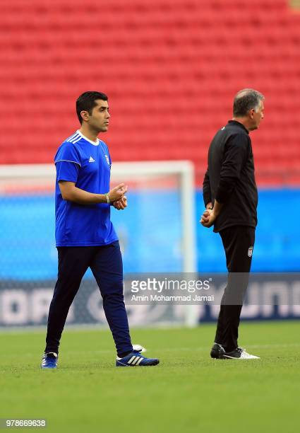 Carlos Queiroz head coach and manager and translator Ariyan Ghasemi look on during a training session before the group B match between Iran and Spain...