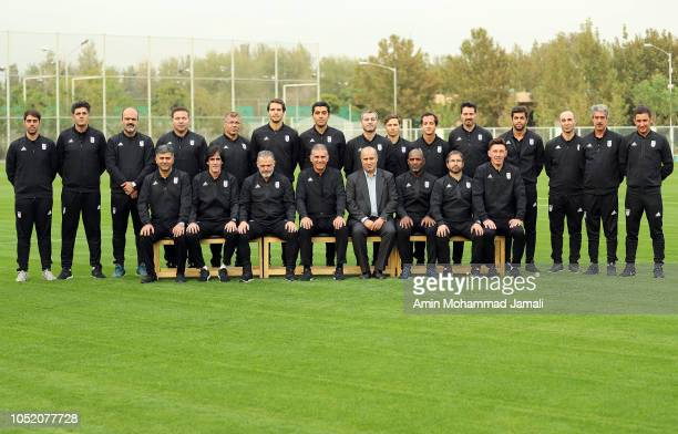 Carlos Queiroz Head coach and manager of Iran and his colleague Pose for team photo during the Iran Training Session on October 13 2018 in Tehran Iran