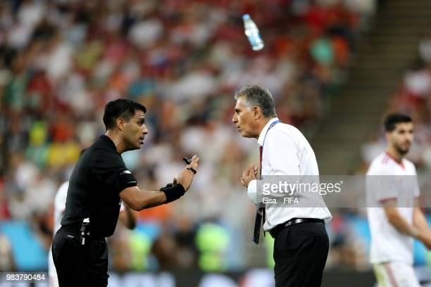 Carlos Queiroz, Head coach of Iran argues with Referee Enrique Caceres during the 2018 FIFA World Cup Russia group B match between Iran and Portugal...