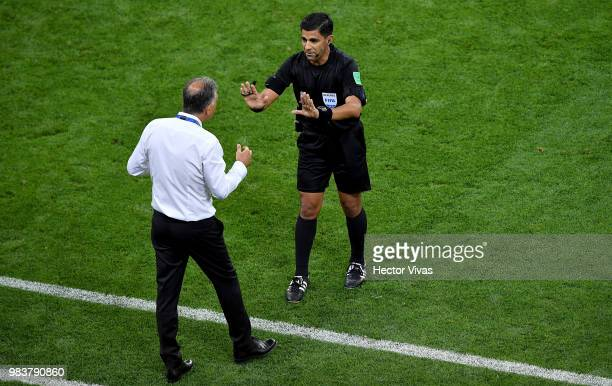 Carlos Queiroz Head coach of Iran argues with Referee Enrique Caceres during the 2018 FIFA World Cup Russia group B match between Iran and Portugal...