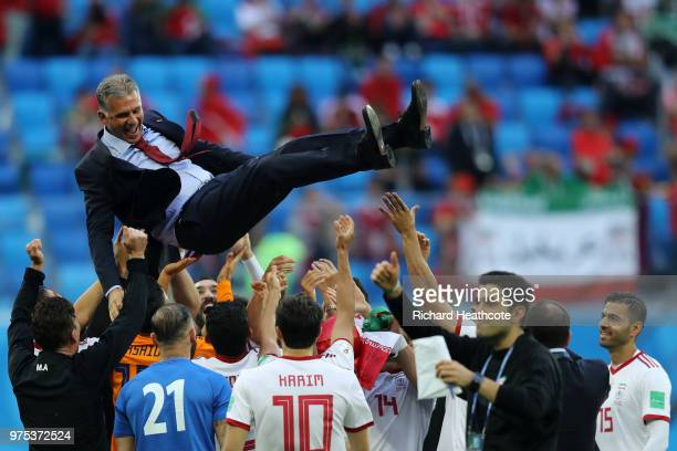 Carlos Queiroz Head coach of Iran celebrates with his team following their side's win during the 2018 FIFA World Cup Russia group B match between...