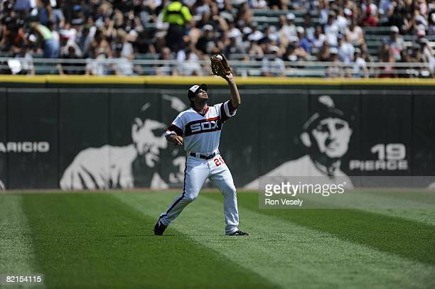 Carlos Quentin of the Chicago White Sox catches a fly ball during the game against the Kansas City Royals at US Cellular Field in Chicago Illinois on...