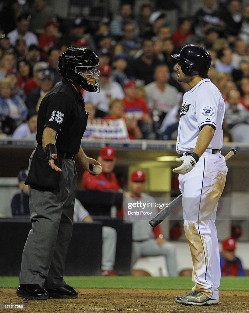 Carlos Quentin #18 of the San Diego Padres argues with home plate umpire Ed Hickox after striking out during the eighth inning of a baseball game against the Philadelphia Phillies at Petco Park on June 25, 2013 in San Diego, California.