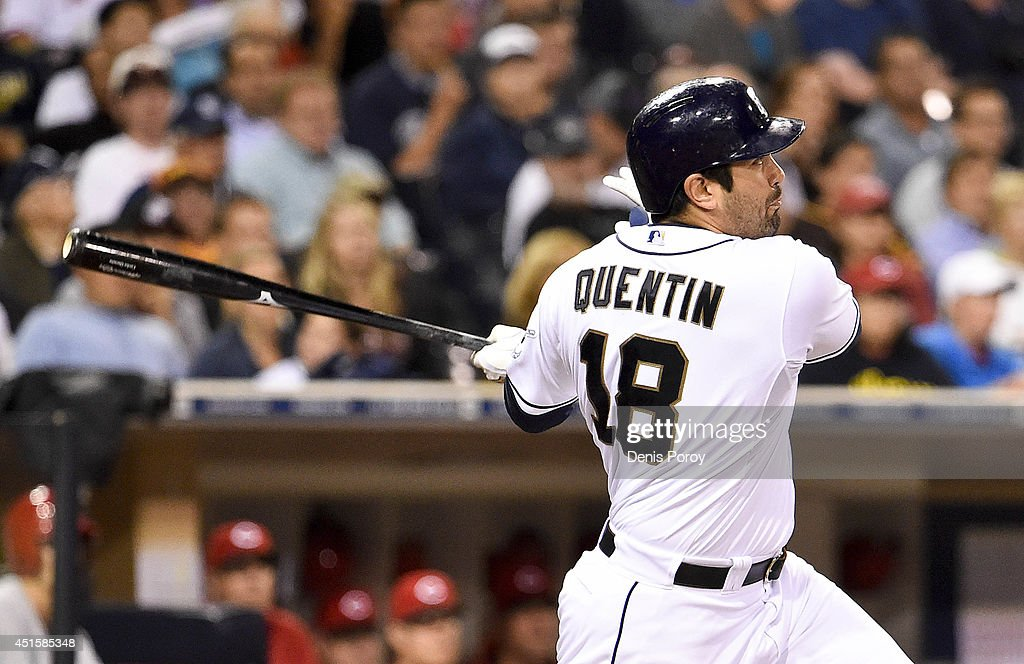 Carlos Quentin #18 of the San Diego Padres hits a two-run home run during the seventh inning of a baseball game against the Cincinnati Reds at Petco Park July 1, 2014 in San Diego, California.