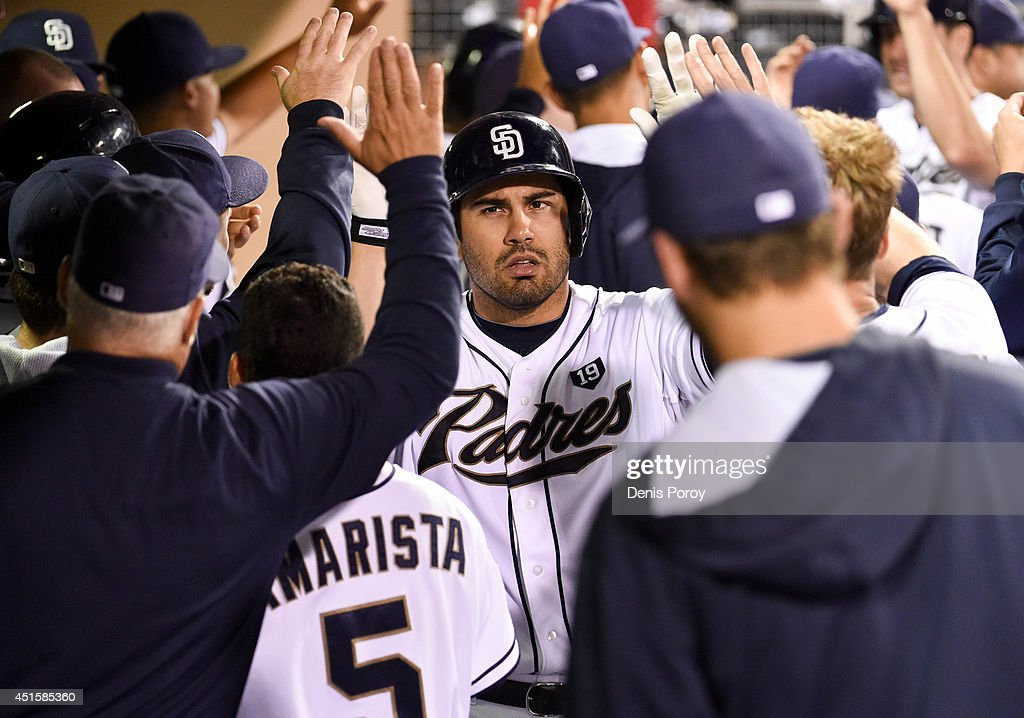 Carlos Quentin #18 of the San Diego Padres is congratulated in the dugout after hitting a two-run home run during the seventh inning of a baseball game against the Cincinnati Reds at Petco Park July 1, 2014 in San Diego, California.