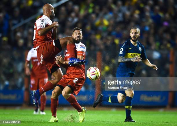 Carlos Quintana of Argentinos Juniors collides with his teammate Miguel Torren during a second leg semifinal match between Boca Juniors and...