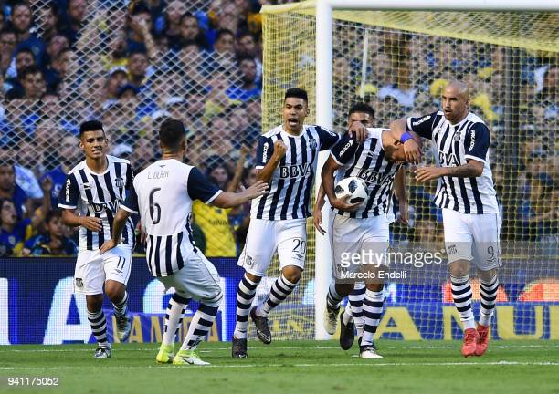 Carlos Quintana of Talleres celebrates with teammates after scoring the first goal of his team during a match between Boca Juniors and Talleres as...