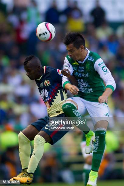 Carlos Quintero of America fights for the ball with Juan Gonzalez of Leon during the 11th round match between Leon and America as part of the Torneo...