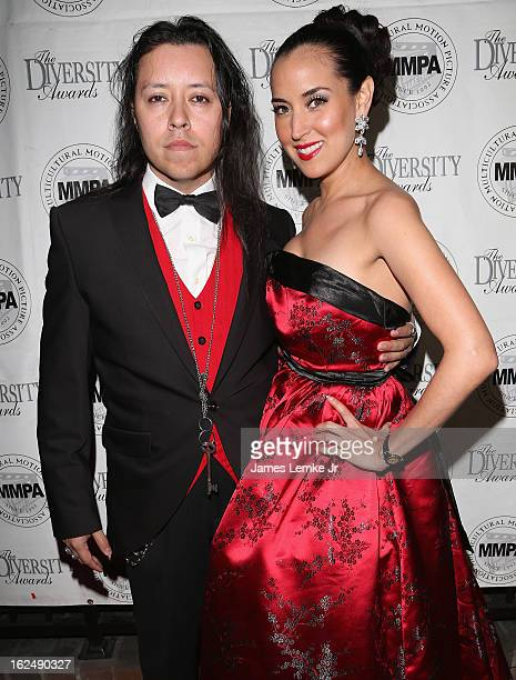 Carlos Ramirez and Burgundy Phoenix attend the Multicultural Motion Picture Association's The Night Before The Oscars The Envelope Please reception...