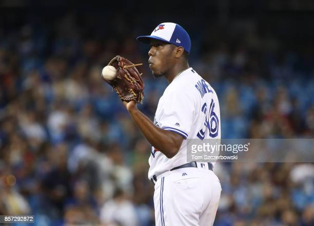 Carlos Ramirez of the Toronto Blue Jays gets a new baseball after giving up a solo home run to Mike Moustakas of the Kansas City Royals in the sixth...