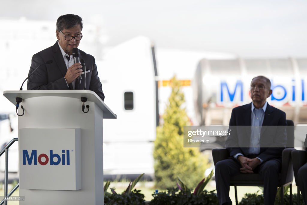 Carlos Rivas, general director of fuel for Exxon Mobil Corp., speaks during the unveiling of the Exxon Mobil Corp. fuel terminal in San Jose Iturbide, Mexico, on Wednesday, Dec. 6, 2017. Exxon Mobil Corp. is joining Chevron Corp. and other U.S. refiners to supply the newly free Mexican fuel market. Exxon Mobil indicated Wednesday that it will open 50 service stations by the end of first quarter and invest more than $300 million in Mexico's energy sector. Photographer: Jonathan Levinson/Bloomberg via Getty Images